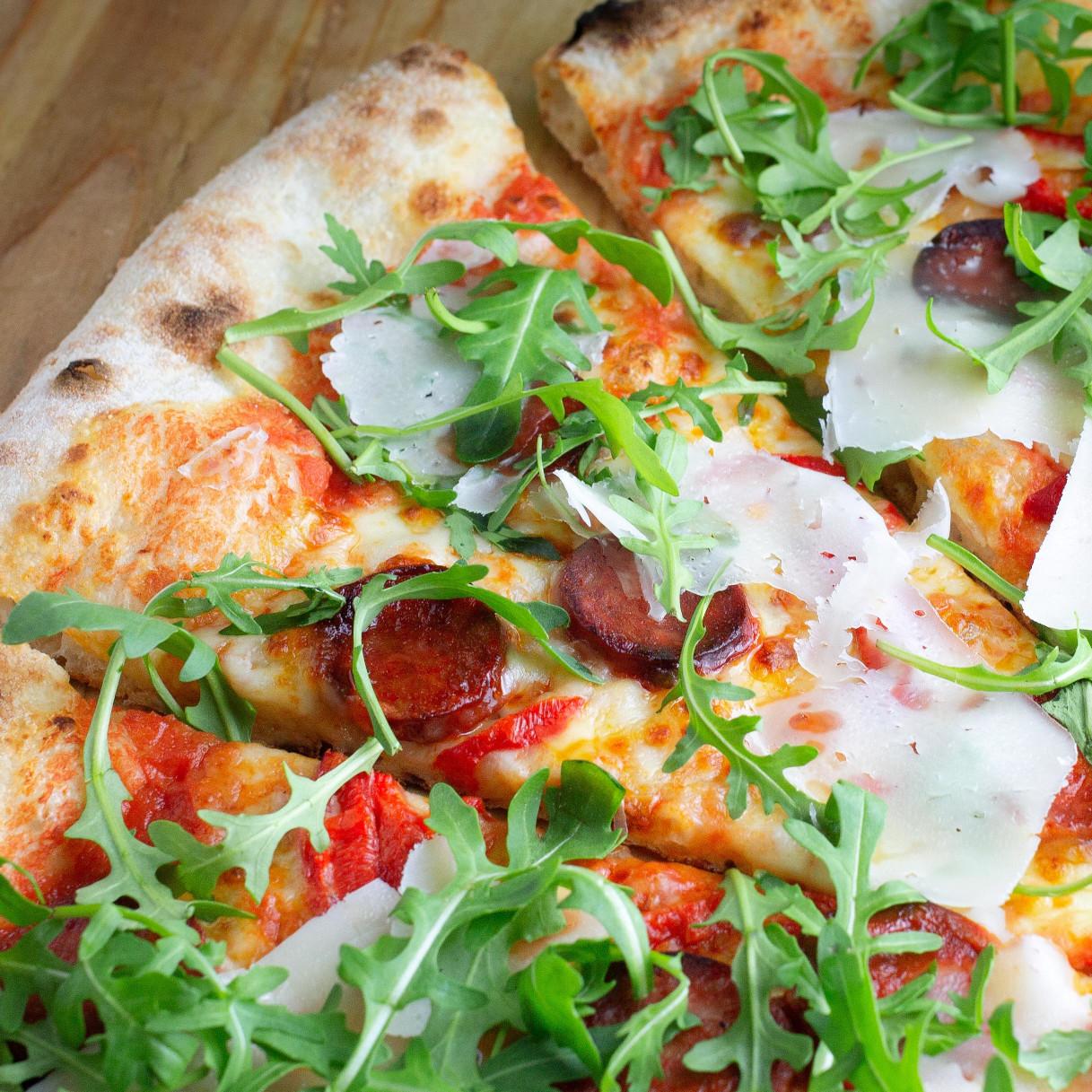 Dinos Rocket Parmesan Pizza