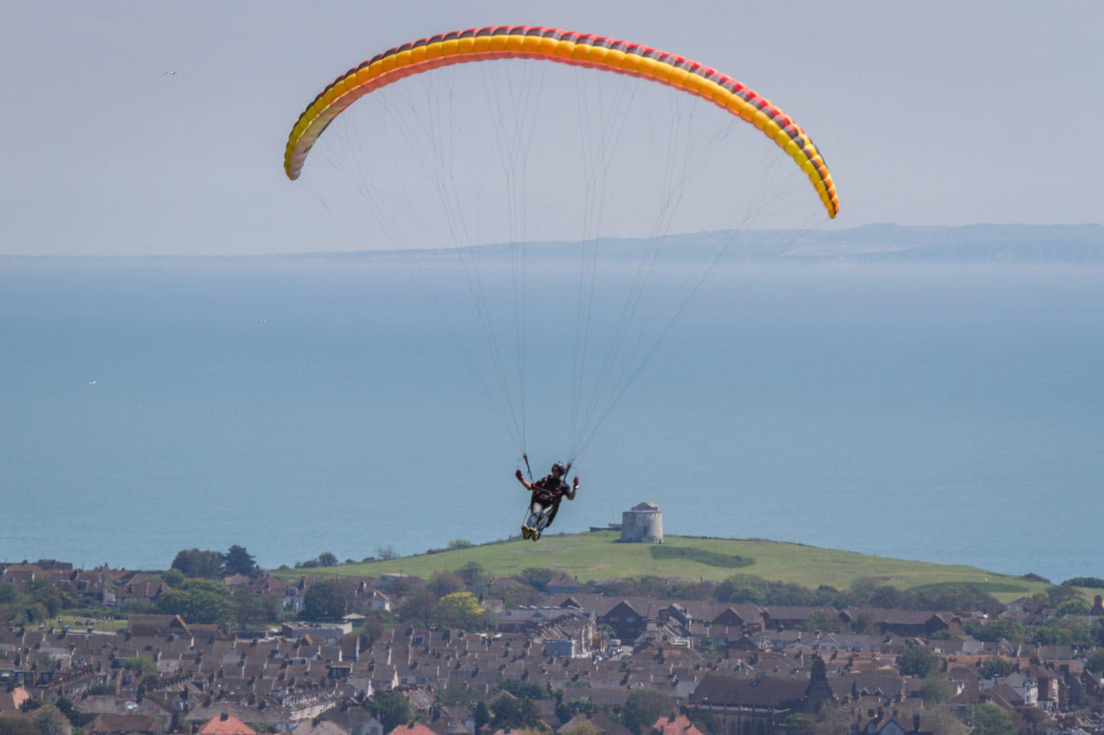 Paragliders over Martello Tower